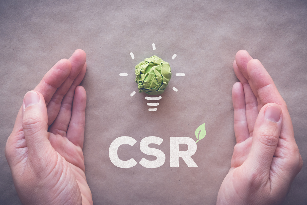 Shutterstock_670341181 Green paper light bulb with CSR, Corporate social responsibility